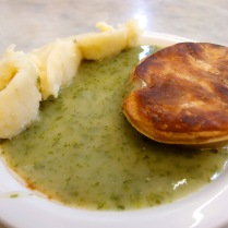 Pie and mash with parsley liquor, a traditional Cockney dish