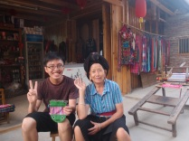 With a 瑶族 (Yao minority) lady. I bought the pouchy thingy for use as a tile bag!